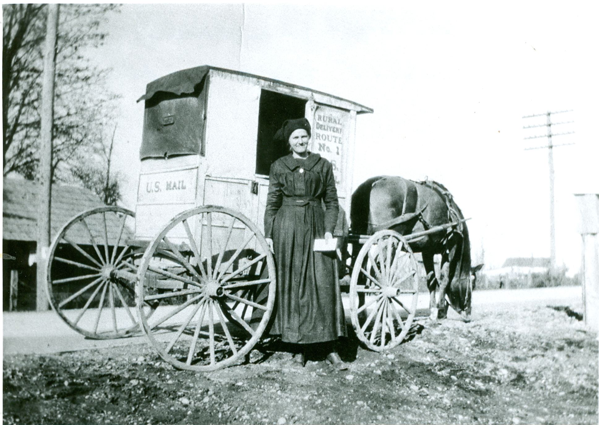 Alice Seaton delivering the U.S. Mail, around 1916