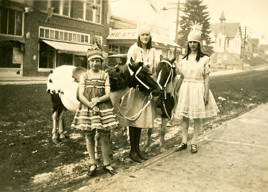 Esther Youngblood  center  and two friends and two ponies are ready for participation in Bothell Historical Museum