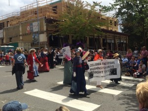 Bothell Historical Museum volunteers celebrate the 106th anniversary of women's right to vote in the State of Washington. Bothell 2016 4th of July parade, looking sotheast at the corner of Main Street and 102 Avenue NE.
