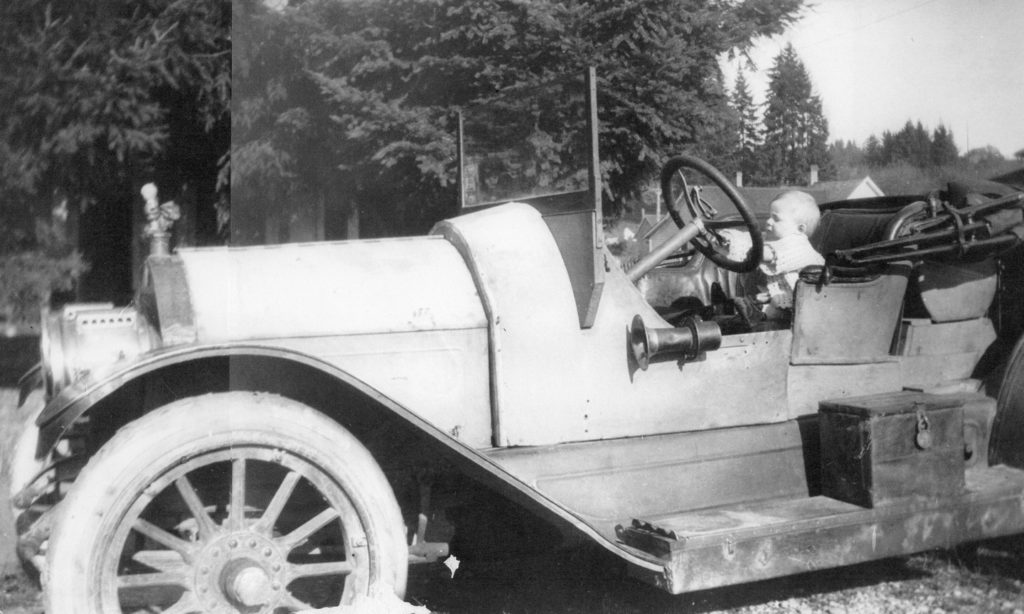 Young driver Ron Green at the wheel of the Mighty Michigan