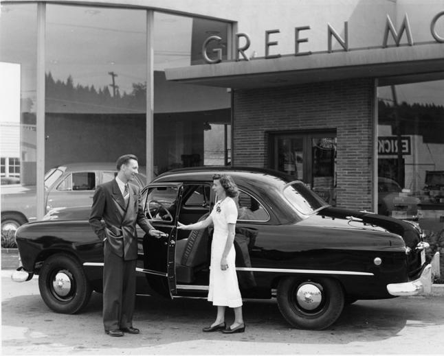 Ron Green selling a new 1949 Ford at Green Motors